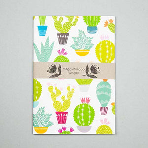 White notebook with belly band with bright coloured cacti and succulent design made by Maggie Magoo Designs
