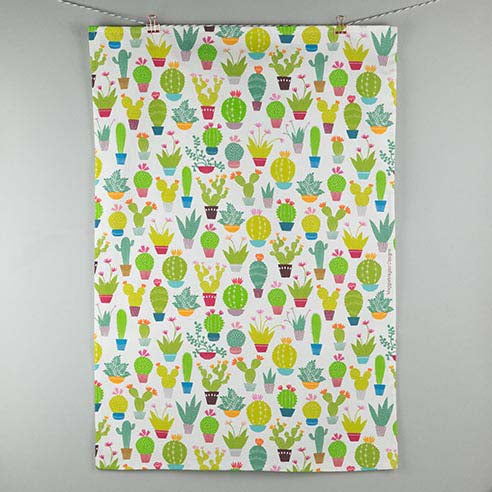 White tea towel with small bright coloured cacti and succulent design made by Maggie Magoo Designs