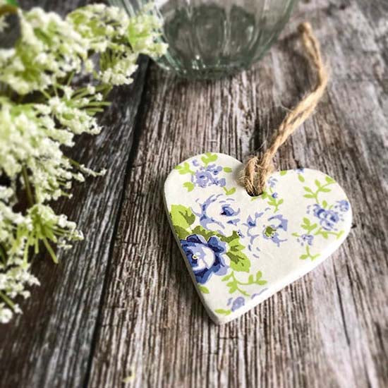 A clay heart with a blue floral vintage design