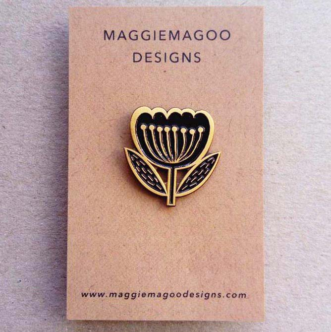 Maggie Magoo Designs Black and gold enamel flower brooch