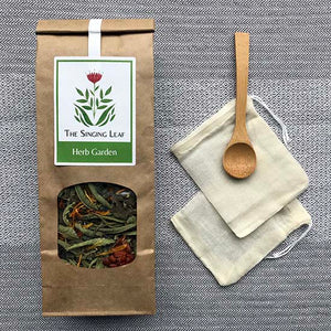 Herb Garden loose tea with bamboo spoon and reusable cotton tea bags