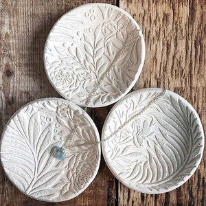 Three white jewellery dishes with botanical print