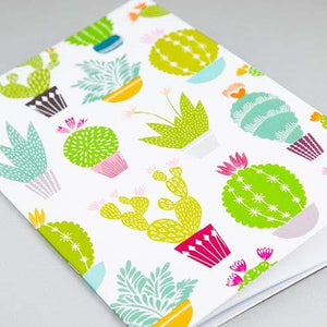 White notebook with bright coloured cacti and succulent design made by Maggie Magoo Designs