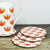Set of four coasters with orange retro tulip design