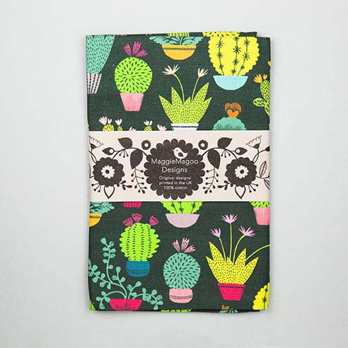 Dark tea towel with small bright coloured cacti and succulent design made by Maggie Magoo Designs