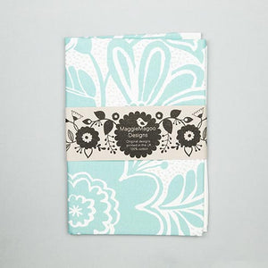 Folded vintage inspired floral damask tea towel in teal and white made by Maggie Magoo Designs