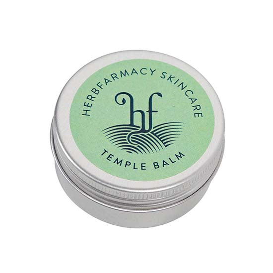 Temple balm in a round metal tin made by Herbfarmacy Skincare