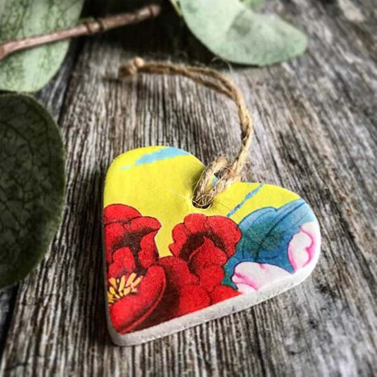 Clay heart with a vibrant  tropical  flower design