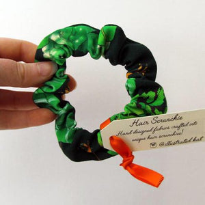 Illustrated Kat Tropical Leaves scrunchie in hand