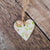 A hanging clay heart with a vintage rose design