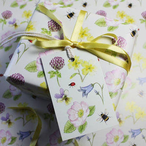 Present wrapped in Wildflower design gift wrap  by RieDesigned