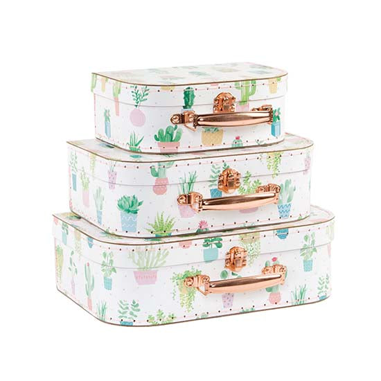 A stack of 3 suitcases with pastel cactus design