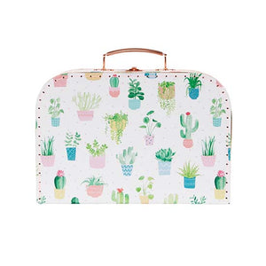 A cardboard suitcase with pastel cactus design