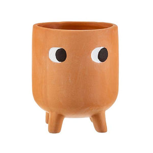 Terracotta planter with painted eyes and three legs