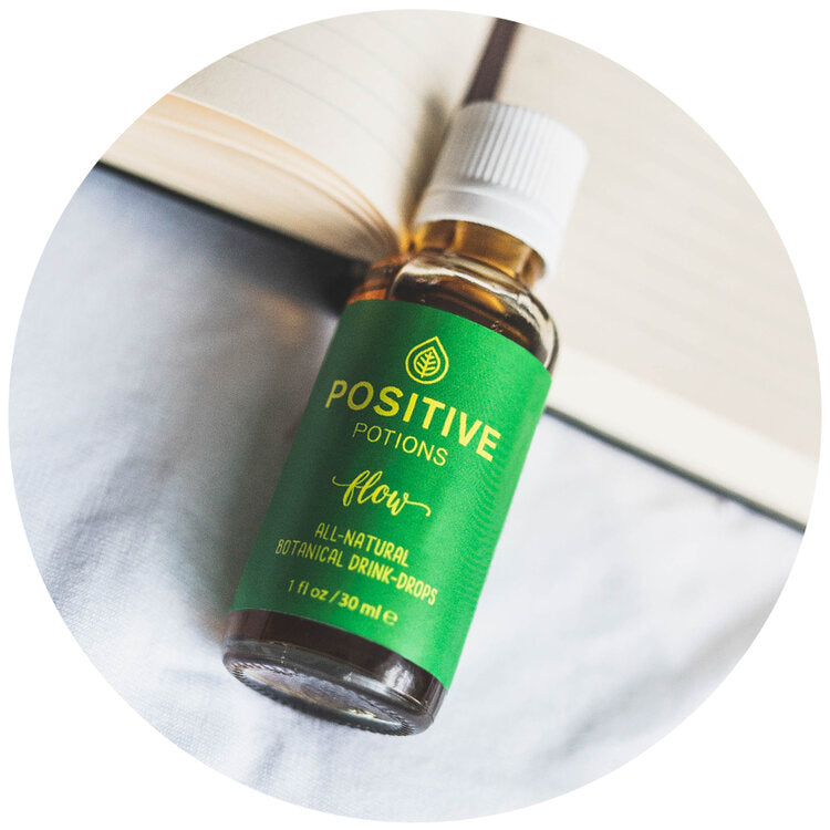 Flow botanical drink drops with green label made by Positive Potions