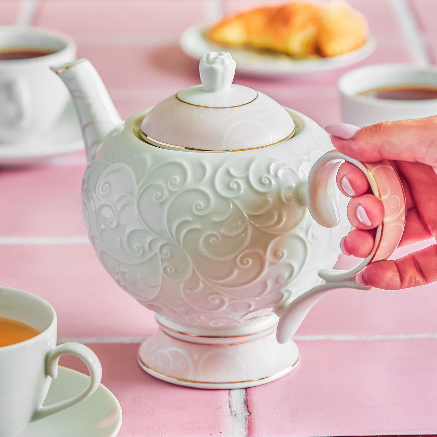 Pink and white embossed teapot