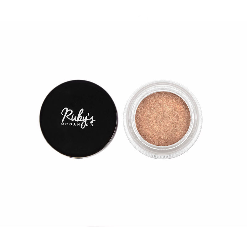 This is an image of Gold Highlighter/Loose Eyeshadow-Stellar from Ruby's Organics on SublimeLife.in. A golden-hued mineral eyeshadow and highlighter.