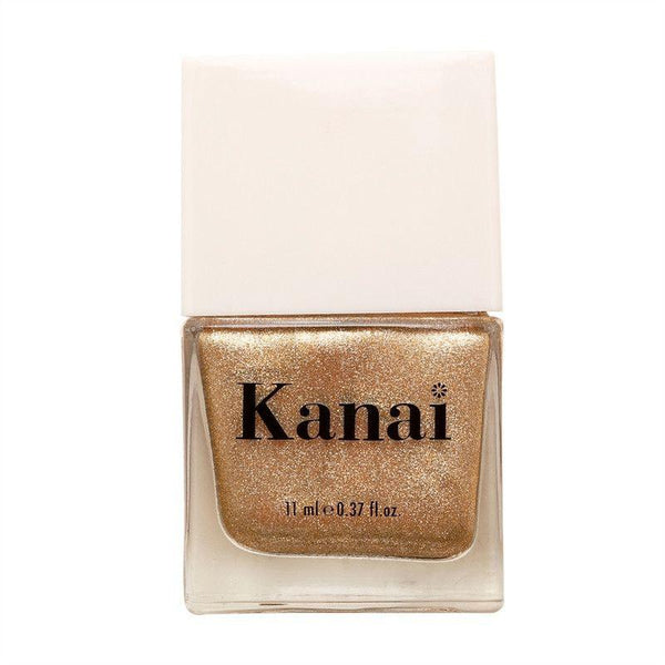 This is an image of nail paint- Shiny Disco Balls from Kanai Organics on SublimeLife.in. The colour is a subtle golden glitter and it is made of toxic-free ingredients.