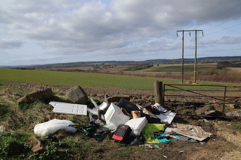 Rubbish dumped in the middle of the countryside.