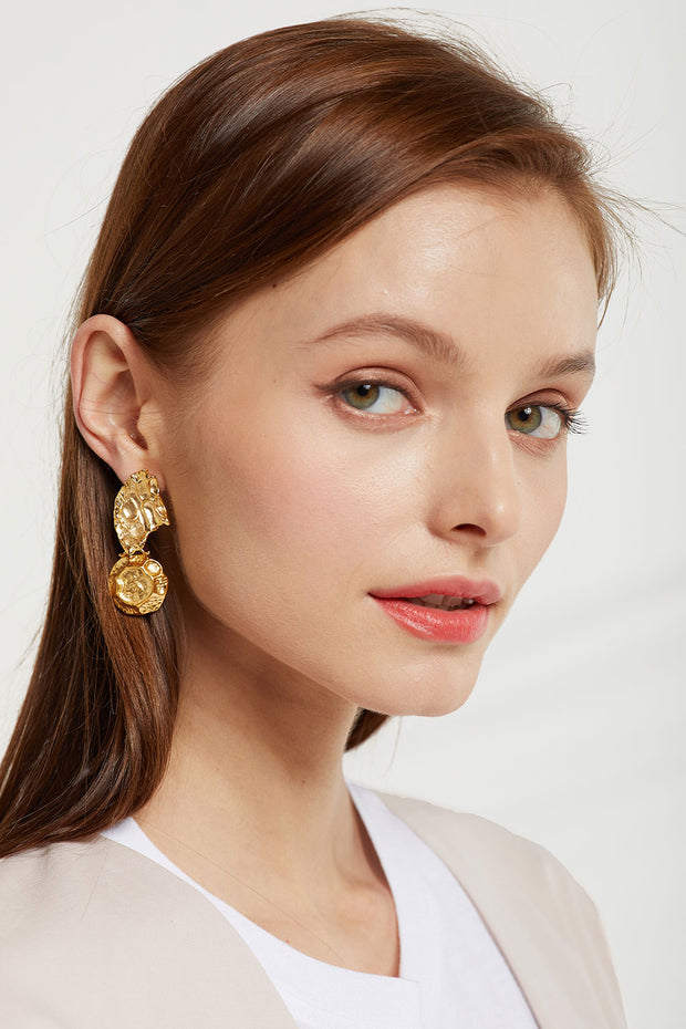 Asymmetric Hammered Drop Earrings by STORETS