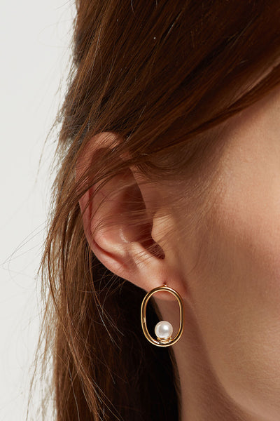 Circle Pearl Earrings by STORETS
