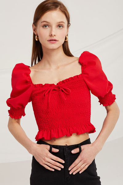 Ariana Off Shoulder Smocked Crop Top by STORETS