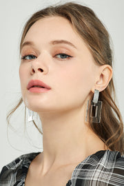 Clear Square Dangle Earrings by STORETS