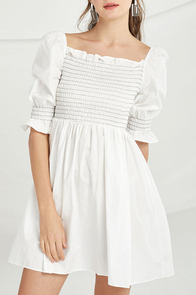 Rylee Smocked Skater Dress by STORETS