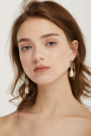 Asymmetric Pearl Dangle Earrings by STORETS