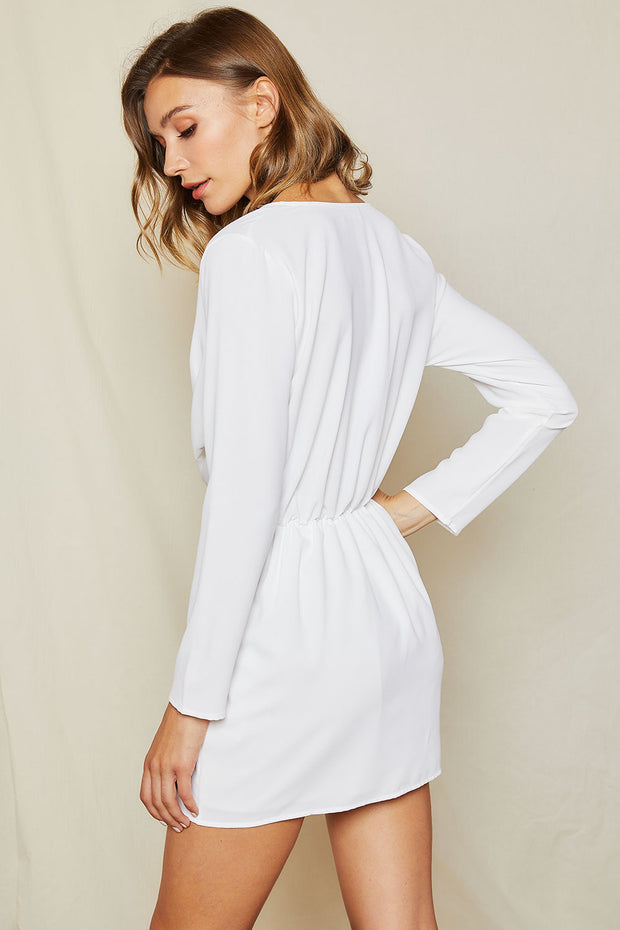 storets.com Lyra Twist Front Plunge Dress