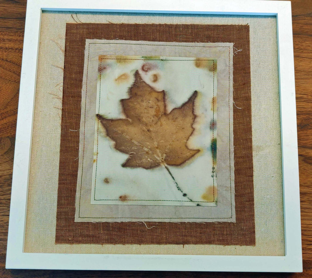 Handprinted maple leaf in white frame