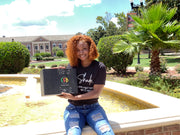Student holding The HBCU Box