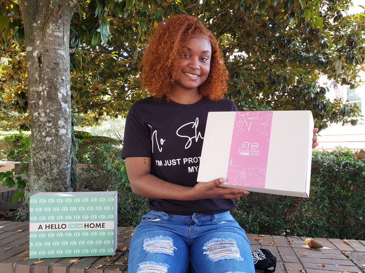 Student holding pink and green Freshman Fun Box