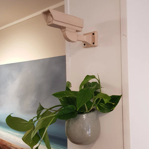 Patrick Colhoun original ceramic sculpture Always Watching Over You cream. cream ceramic sculpture of a CCTV camera