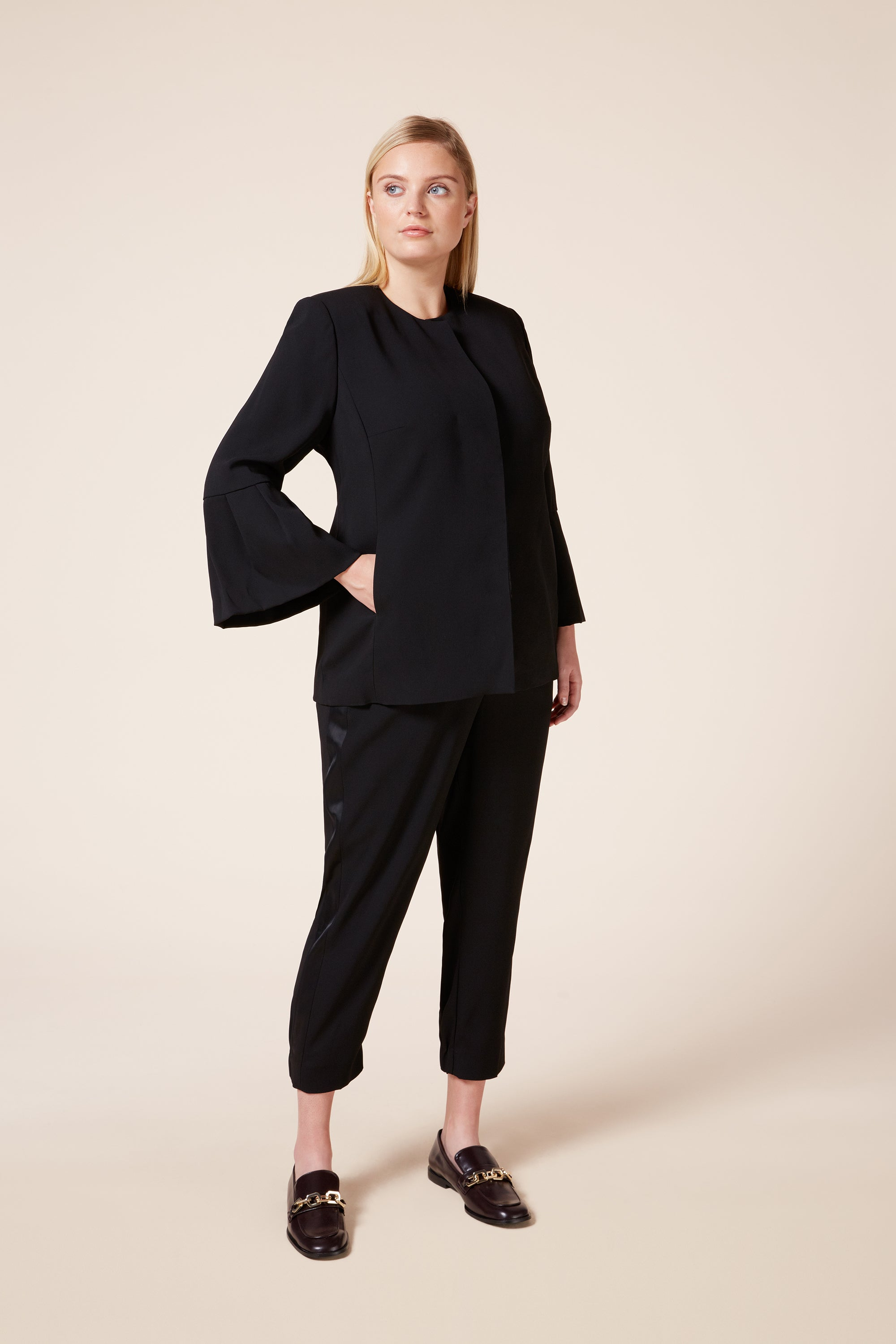 Plus size black tailored blazer with flounce sleeves and pockets