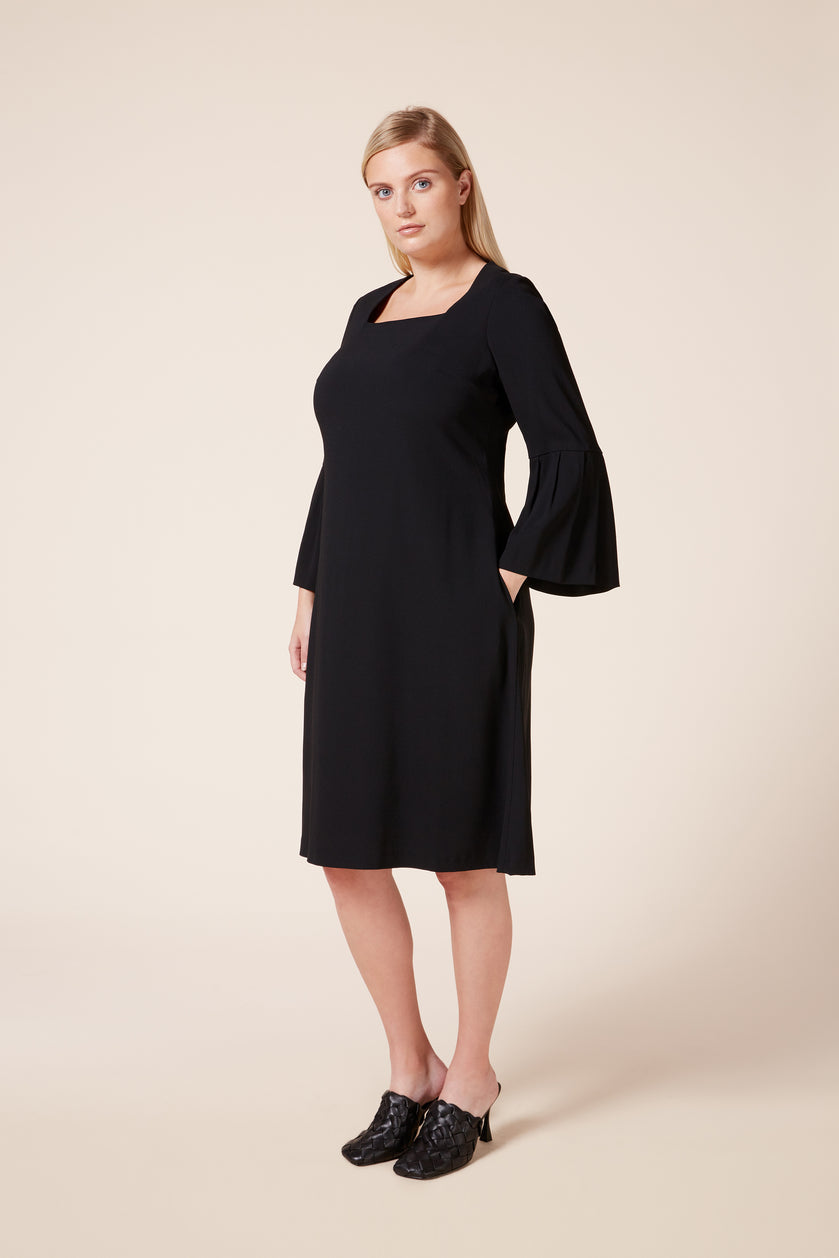 plus size black dress with trumpet sleeves side pockets and square neck