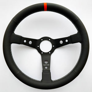 Custom steering wheel in black aluminum with air-cooled leather by Tactico Racing Atelier
