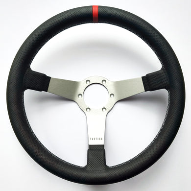 Custom steering wheel with perforated leather by Tactico Racing Atelier