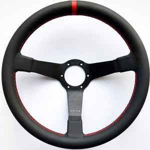 Custom steering wheel in black aluminum, full grain leather and red stitching by Tactico Racing Atelier