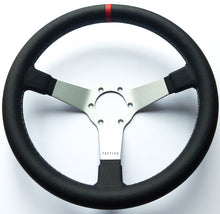 Custom steering wheel in brushed aluminum with perforated leather by Tactico Racing Atelier