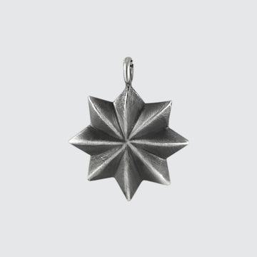 Eight Pointed Black Star Charm