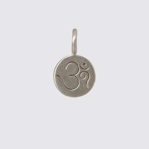 "Hand-etched, silver ""Om"""