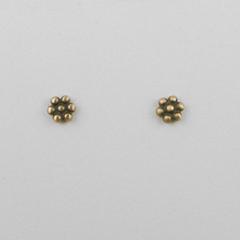 Tiny granulated flower stud in 10K rose gold