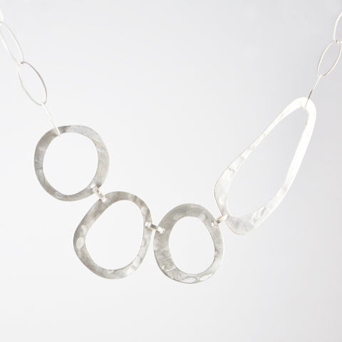 Abstract Hammered Cut-Out Circle Bib Necklace