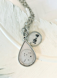 zodiac necklace with a birth date