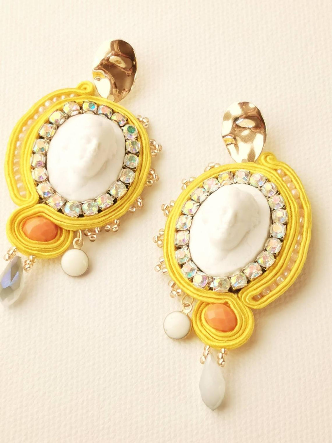 Wearable Art elegant yellow statement soutache earrings dangle with Aphrodite Cameo & crystal rhinestones. The revival in the appreciation of the cameo jewelry is here.