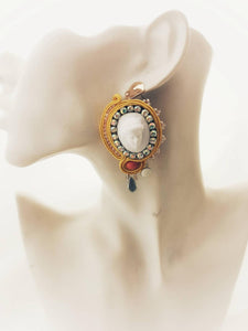 These high fashion cameo earrings Features : yellow silk soutache , crystal rhinestones , 3d hand made cameos , glass beads, seed beads , backed with yellow leather.