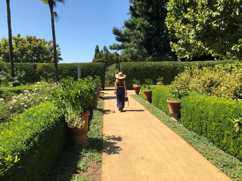 Walking out of garden at Chateau St. Jean, Sonoma, CA.  Holding Post Bag.
