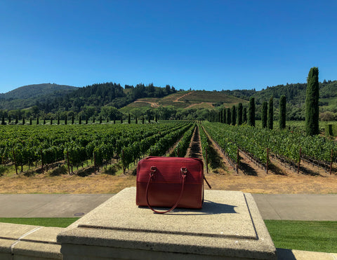 Post Bag in front of vineyard rows at Ferrari-Carano