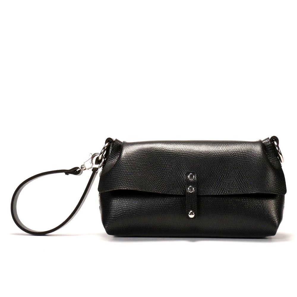 Ebony (Black) wristlet with shoulder strap to double as crossbody.  Hand riveted together with black rivets and silver hard wear.  This is a small bag the holds just the essentials and has a button closure in front.  Detachable wristlet strap.